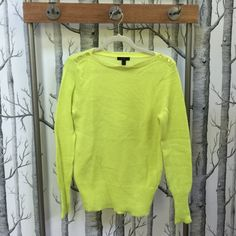 JCrew Buttoned Boat-Neck Sweater JCrew Boat-Neck Buttoned Sweater. Neon Yellow.  JCrew worked hand in hand with one of their favorite Italian mills to develop this special blend of wool and mohair yarns (light and lofty feel). In a long and lean silhouette with a forever-flattering boatneck, it's finished with dyed-to-match mother-of-pearl buttons for a little shimmer at the shoulder. Polyacrylic/wool/mohair in a 7-gauge knit. Long sleeves. Rib trim at cuffs and hem. Hits below hip. Dry…