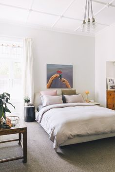 """MASTER BEDROOM The couple's private space sees a Tonk stool by Charles Hinckfuss, bed linen from Nest and Città, and a Line table lamp by Douglas and Bec combined with pre-loved timber pieces, including a favourite """"hand-me-down"""" table from Kate's parents."""