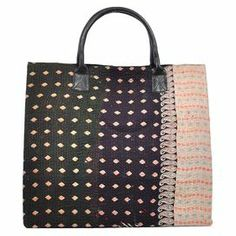 """Showcasing an eye-catching geometric motif and leather handle, this hand-stitched weekender bag is perfect for a trip to the beach or as a jetset companion. Repurposed from a traditional cotton sari, it features 2 inner pockets and full interior lining.   Product: Weekender bagConstruction Material: Cotton and leatherColor: MultiFeatures:  Repurposed from traditional sarisHand-stitchedOne of a kind Full interior lining and two pocketsDimensions: 19"""" H x 20"""" W x 12"""" D"""