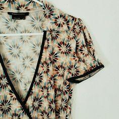 BCBGMAXAZRIA ☆ Wrap Dress Short Sleeve. Collar. V neck. Wrap Dress style that ties in the back. Pretty color pallete- black, tan, brown, blue, white. EUC. 95% polyester.  3% spandex. BCBGMaxAzria Dresses