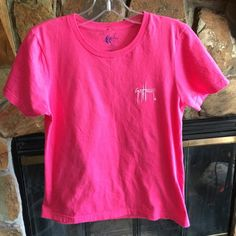 ⚡️⚡️Guy Harvey Shirt Size small pink Guy Harvey shirt. The back features swordfish. This is a size small and would fit an xs-small best because it's fitted. Only worn once. Guy Harvey Tops Tees - Short Sleeve