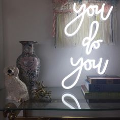 """Thanks to @britelitetribe I got my husbands favorite saying, """"You do you"""" turned into a neon sign for our home (for Christmas). It's going to be a constant reminder for me to be fearless and true to myself. I can't wait to figure out where we'll be hanging it! #lillidokken #dokkenabode #britelitetribe  #britelitetribecustom #anthrohome #neon #oneofakind #accessories #mystyle"""