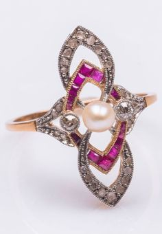 An antique gold, platinum, diamond, ruby and cultured pearl ring, 19th century. #antique #ring