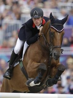Scott Brash, of Great Britain, rides his horse Hello Sanctos, during the jump-off in the equestrian show jumping team competition at the 2012 Summer O