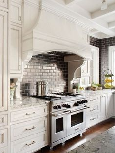 Kitchen Trends Here to Stay Gun-metal gray tile to the ceiling makes a strong statement in this otherwise sparkling white kitchen.Gun-metal gray tile to the ceiling makes a strong statement in this otherwise sparkling white kitchen. Kitchen Hoods, Better Homes, Home, Home Kitchens, Kitchen Remodel, Kitchen Design, House, Kitchen Trends, Dream Kitchen