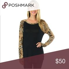 ❤️BUY this today and GET ❤️discounted shipping❤️ ❤LET me know if you want this today and I can drop the price.  They will arrive tomorrow and I can ship Wednesday.  ❤️Black and Leopard top; print raglan sleeves.  Curved hem tunic.  95% rayon 5% spandex.  Made in the USA🇺🇸.               ❤️like this listing and I will drop the price ❤️❤️❤️❤️  🚭s͏͏m͏͏o͏͏k͏͏e͏͏ f͏͏r͏͏e͏͏e͏͏ ❌P͏͏P͏͏ ❌T͏͏r͏͏a͏͏d͏͏e͏͏s͏͏ ✔F͏͏a͏͏s͏͏t͏͏ 📬 ✔u͏͏s͏͏e͏͏ t͏͏h͏͏e͏͏ buy button Tops Tunics