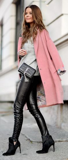 Beautifully matched salmon coat with the gray knit and black leather pants. Not to mention the YSL clutch.
