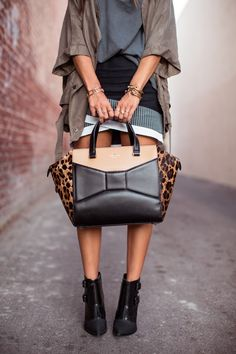 LOVE the bag ... see the leopard print peeping out from the sides?  Animal print is in this season!