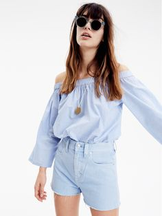 madewell off-the-shoulder top worn with the raw-hem shorts + sunglasses. call 866-544-1937 or email shopfirst@madewell.com to pre-order.