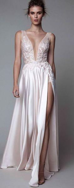 Sleek plunging neckline wedding dress with silk thigh-high slit skirt; Featured Dress: Maggie Sottero