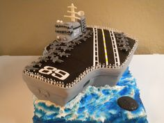 Aircraft Carrier Cake - This is my first attempt at making an aircraft carrier.  I learned a lot.  The planes and men were fun.  Made out of fondant.