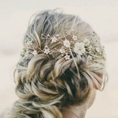 bridal undo inspiration | fishtail braided bun with delicate floral-inspired headpiece