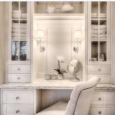 Elegant Bathroom With Silver Moroccan Pouf Tucked Under A Floating Dressing  Table Below A Sunny Window Dressed With A White And Jade Green Striped  Roman ...