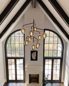 Views of our Odyssey chandelier from the second floor🙌 Design: @tracirhoadsinteriors | Family room lighting, Modern chandelier, Dining lighting Troy Lighting, Dining Lighting, Room Lights, Ceiling Lights, Family Room Lighting, Modern Chandelier, Floor Design, Second Floor, Entrance