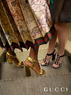 Presenting the new Willow t-strap sandals from Gucci Spring Summer 2016. In metallic gold or black leather, a curved heel, and embellished with GG pearls and studs.: