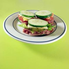 Cucumber sandwiches loaded with meat and veggies. Cheese optional.
