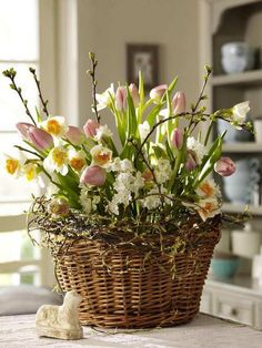 Floral arrangement in wicker basket- Blumengesteck im Weidenkorb Tulips and daffodils get along great. Wrapped in wicker basket with branches, they become an Easter arrangement. Easter Flower Arrangements, Easter Flowers, Flower Centerpieces, Spring Flowers, Floral Arrangements, Easter Centerpiece, Easter Decor, Spring Bouquet, Table Centerpieces
