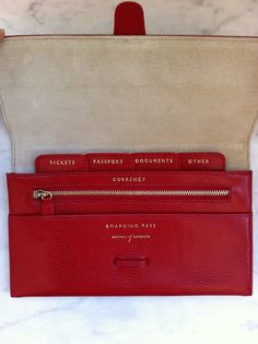 Aspinall Red Leather Travelling Wallet/Passport Holder/Luggage Tags via The Queen Bee. Click on the image to see more!