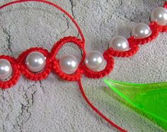 """Tatting the chain around the other side of the bead, we come to the join. I opted to use the """"Alligator Join"""". The core thread goes under t..."""