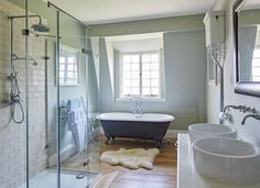 Green Bathroom with Metro-tiled Shower and Roll-top Bath