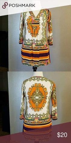 Beautiful tunic Great for anywhere, any time. Soft, easy styling. Great colors. Charlie Paige Tops