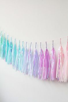 Mermaid Rainbow Tassel Garland (Pastel Iridescent) perfect for a mermaid inspired birthday, baby shower, bridal shower or even a graduation party! #finfun #mermaids