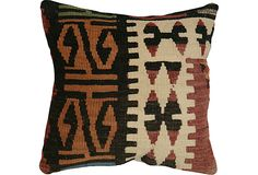 Pillow made from a vintage handwoven kilim from western Turkey. Backed in ivory cotton, zipper closure.