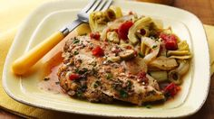 Add richness to chicken breasts by topping with Italian dressing, tomatoes and artichokes.