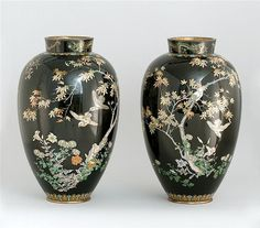 "PAIR OF KYOTO SCHOOL CLOISONNÉ ENAMEL VASES Meiji Period In seed form with bird, flower, and maple leaf designs a black ground. Heights 19"" (48.3 cm)."