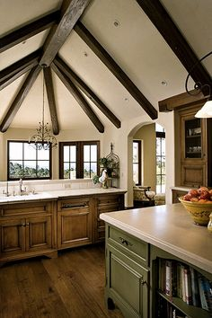 Beams.  Arched doorway.  Windows instead of wall cabinets around sink.  Island painted instead of stained. <3