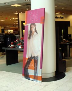 44d71fd8be14 fabric printed graphic is stretched on frame for free standing display .  www.color-