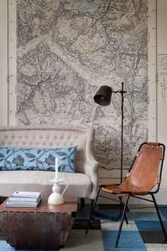 Love the sleek aviator style leather chair and fabulous oversized topographical mag.