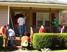 Alumni in Fayetteville volunteer with A Brush With Kindness, a Habitat for Humanity group.
