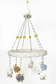 Such a cute mobile! Love the hand knit sheep!