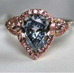 Fancy blue diamond and rose gold ring.
