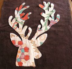 Use this same idea. Cut christmas shapes out of wrapping paper and use as ornaments!