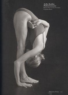 Ardha Baddha Padmottanasana-Bound Half Lotus Standing Forward Bend   Yoga Journal 2008.