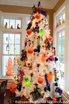 """Christmas Tree Halloween Tree "" probably you never thought of this idea. Halloween trees are a thing, and our holiday-obsessed hearts are filled with joy. Spooky Halloween, Halloween Christmas Tree, Feliz Halloween, Adornos Halloween, Holiday Tree, Holidays Halloween, White Christmas, Halloween Crafts, Holiday Fun"