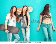 Beautiful girls sitting over a skateboard