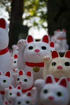 Japanese  'beckoning cat'  Maneki-neko,  which is often believed to bring good luck to the owner.