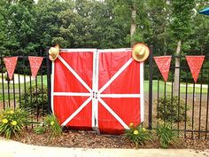 Barn doors, bandana pennant and cowboy hats make for great western party decorations. Click on the picture for more ideas.