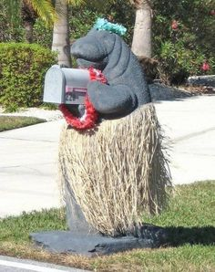 Miss Manatee! She is quite the beauty and almost looks like she's doing a little dance with the high winds of the day blowing her grass skirt! I've seen manatee mailboxes before, since we're in Florida, but this one is just heads and tails over the rest! Funny Mailboxes, Home Mailboxes, Unique Mailboxes, Painted Mailboxes, Mailbox On House, You've Got Mail, Junk Mail, Deco Originale, Make It Yourself