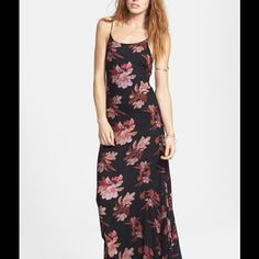 NWT free people chasing star maxi dress Make a stunning entrance in a breezy, floor-sweeping maxi dress featuring a strappy camisole bodice with a plunging V-back and a billowy skirt with a surged hem. The allover floral print fashions a quintessential sunny-day look. Unlined. 100% rayon. By Free People; imported. Machine wash cold, line dry. Free People Dresses Maxi