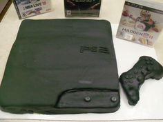 Playstation 3 Cake with a hand carved cake of the controller.  All buttons and detail done in chocolate fondant.