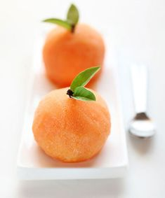 Such a simple, elegant way to serve a scoop of sorbet.  Freeze scoops in hollowed-out oranges to look like the fruit itself, topped off with a clove and fresh basil sprigs. It's an extra step, and requires a bit more freezing time, but the adorable sorbet fruit would be an awesome end to a classy summer dinner party.