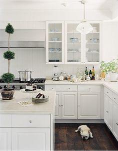 Dark floorboards white bench & cupboards