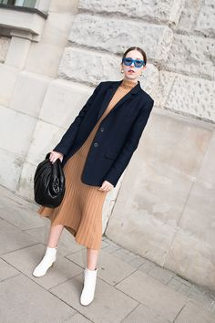 Beige pleated dress under a double breasted navy blue blazer paired with  white ankle boots. d60ebe92d3