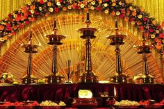 Vibrant indian stage decor complete with the peacock lamp typical guruvayoor wedding planner gallery best free home design idea inspiration junglespirit Gallery