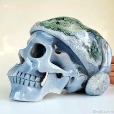 Jack Frost Amethyst Agate Geode Carved Crystal Skull with Stocking Cap Sculpture  Happy Holidays! Our Jack Frost crystal skull sculpture brings our very best wishes and thanks to all of our friends and followers! We wish for everyone a very Merry Christmas and wonderful holiday celebrations with good food and drink, good friends, and good will! Visit Skullis.com to see our other amethyst agate crystal skull jewelry and sculptures. Jack Frost, Skull Island, Mask Design, Agate Geode, Human Skull, Crystal Skull, Skull Jewelry, Skull And Bones, Skull Art