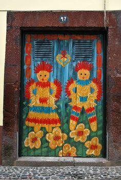 Hey, it looks like a Raggedy Ann and Andy door!     Rua Santa Maria. Funchal. Madeira.